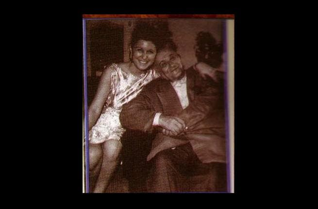 With Dad: Her father, Mohammad Hosny, was an Egyptian calligrapher.  She arose from humble origins and came with little in the way of finances or education. She was the 10th of 17 siblings, so had to learn the art of sharing, not to mention any other arts she pursued.