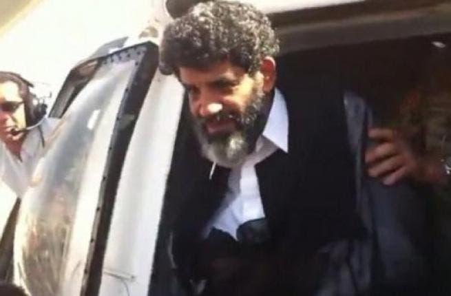 Abdullah al-Senussi arrives at a prison in Tripoli on September 5, 2012 (AFP file photo)