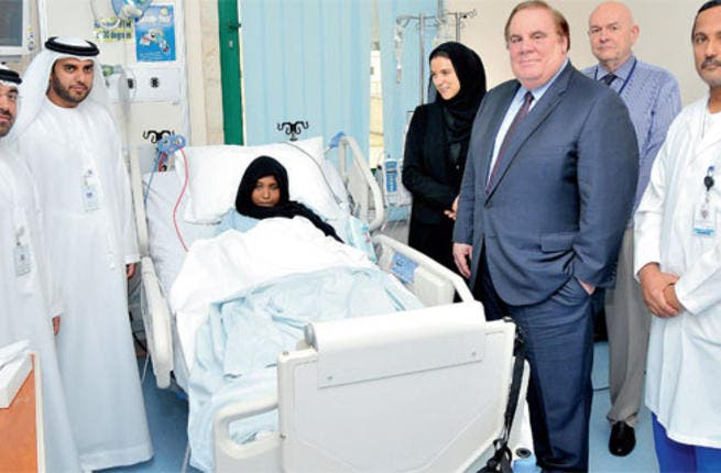 Latifa Sai'ed with doctors after her successful surgery. Image from Khaleej Times.