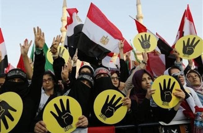 Egyptian courts have banned all Muslim Brotherhood activities in the country, but will hear an appeal on this decision October 22nd (Courtesy of Crispian Balmer/Reuters)