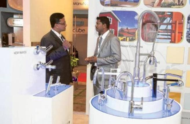 Exhibtor explaining the products of Rak Ceramics, during the Big 5 Show being held in Dubai Trade center.