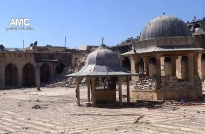 An image grab taken from a video uploaded on YouTube on Wednesday, allegedly shows the rubble of the minaret (background) of Aleppo's ancient Umayyad mosque. (Image: AFP photo / YouTube)