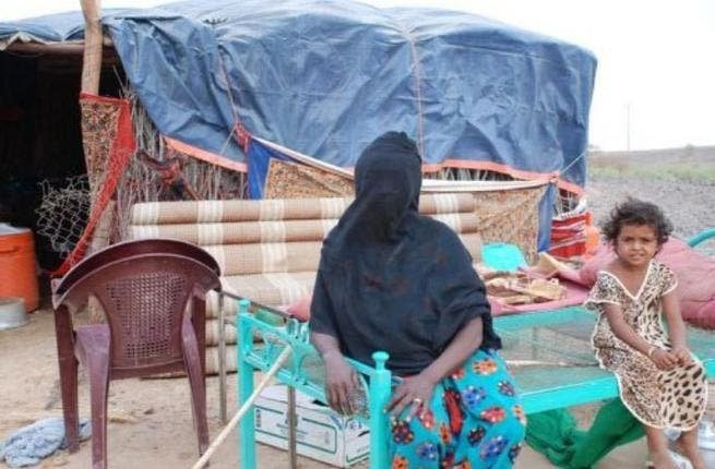 Umm Ali lives in a straw hut without electricity with her seven children