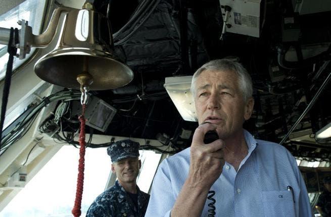 US Secretary of Defense Chuck Hagel addresses the crew of the USS Freedom (AFP/ US Department of Defense)
