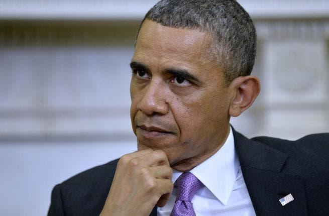 US President Barack Obama watches as Emir of Qatar Sheikh Hamad bin Khalifa al-Thani speaks to the media (Jewel Samad/ AFP)