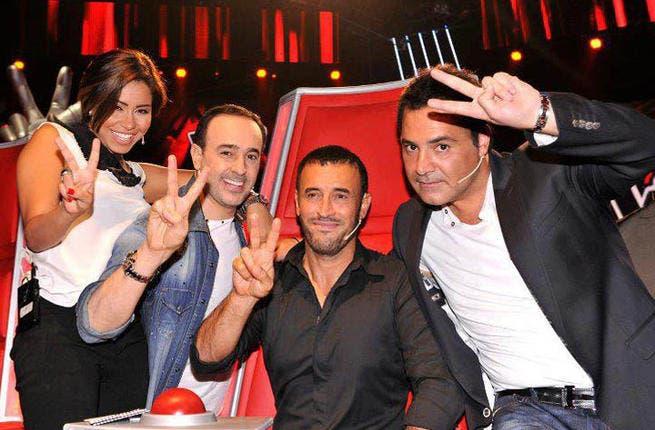 Two, please! Kadim Al Sahir on the set of 'The Voice' with fellow judges