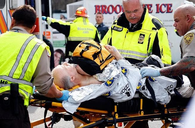 A man is loaded into an ambulance after being injured in the Boston Marathon bomb attacks (AFP/ Jim Rogash)