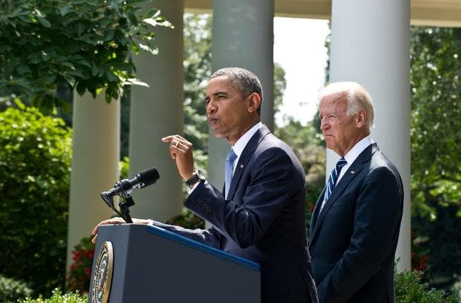 UNITED STATES, Washington : US President Barack Obama, with US Vice President Joe Biden, speaks on Syria in the Rose Garden at the White House in Washington on August 31, 2013. AFP PHOTO/Nicholas KAMM