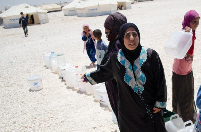 Where people flow, water runs dry:  The influx of refugees could be squeezing the camp dry as Syrians stand in line to fill bottles of water. Many refugees blame Zaatari's water for illnesses contracted in the camp. (AlBawaba/J. Zach Hollo)