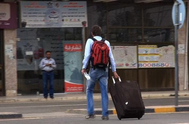 YEMEN, SANAA : An image grab taken from an AFPTV video shows people heading to Sanaa International Airport as they prepare to leave Yemen on August 6, 2013. The United States ordered Americans to leave Yemen
