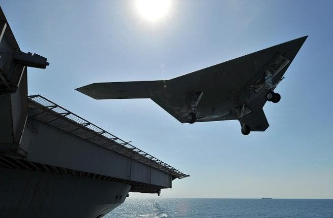 An unmanned drone carries out a touch go landing in the Atlantic (US Navy/AFP)