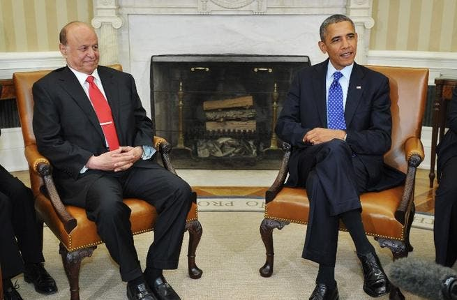 UNITED STATES, Washington : US President Barack Obama and Yemen's President Abdrabuh Mansur (L) are seated as they wait for the press to arrive before they speak in the Oval Office of the White House on August 1, 2013 in Washington, DC.  AFP PHOTO/Mandel NGAN