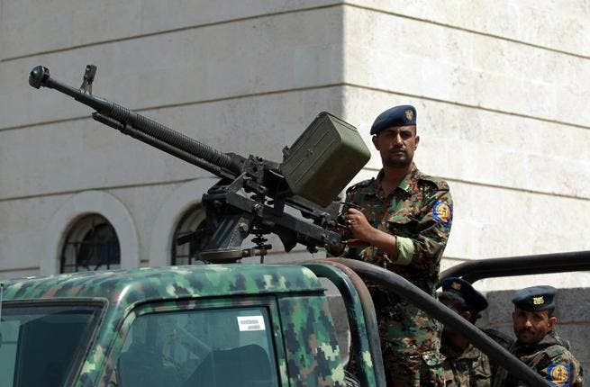 Yemeni soldier on high alert after attacks. [AFP]