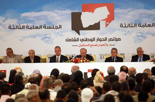 Yemen's President Yemeni President Abdrabuh Mansur Hadi (C) speaks during the closing session of a conference on national dialogue in the Yemeni capital Sanaa. (Image credit: AFP)