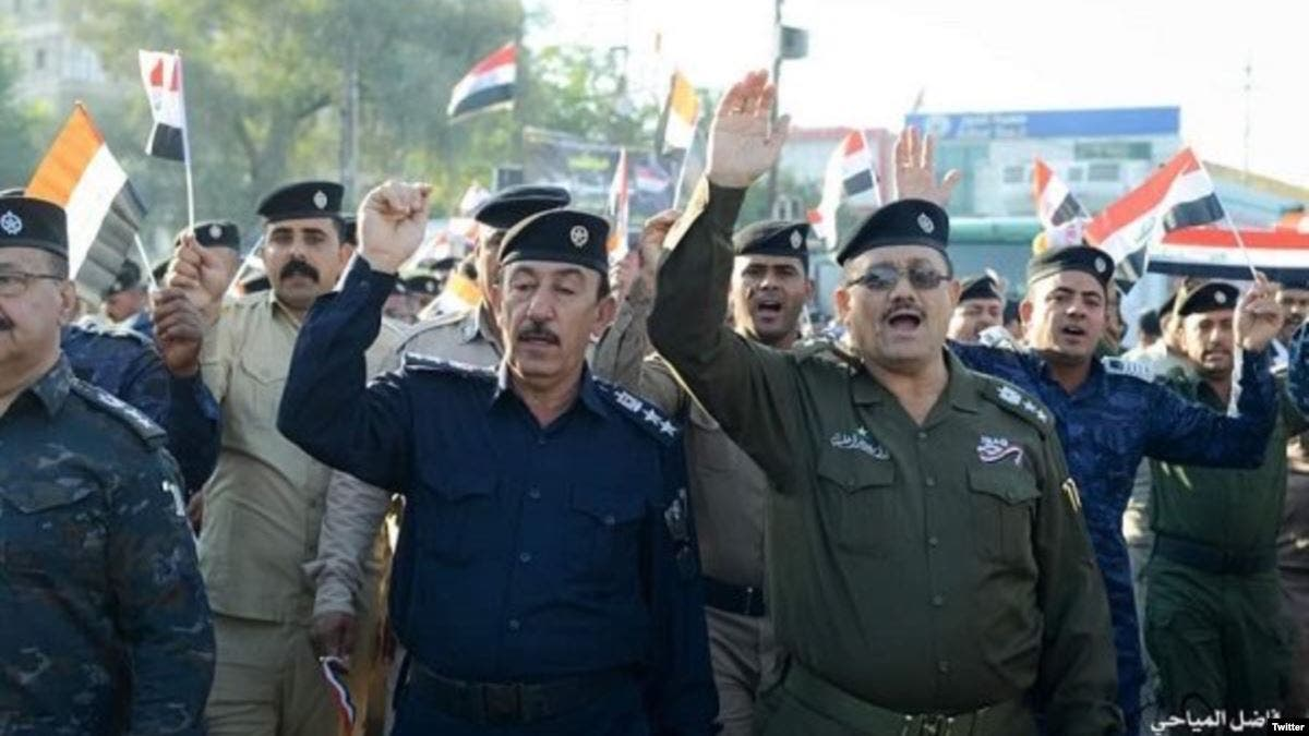 قوات الامن تتظاهر في كربلاء تضامنا مع المحتجين