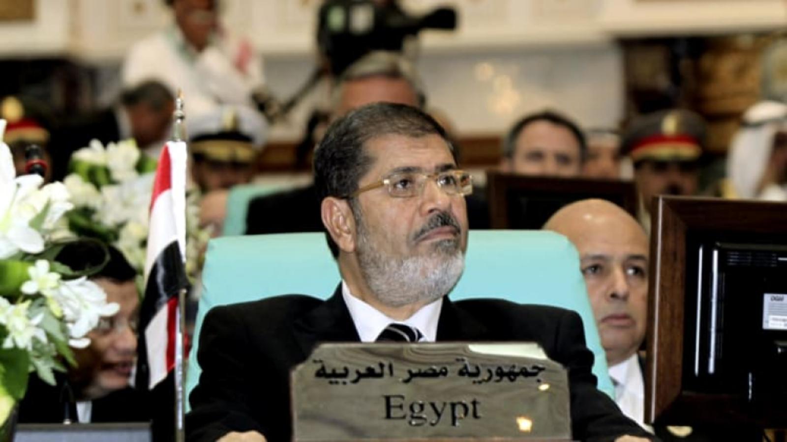 """نجل مرسي يتساءل عن """"مقتل"""" أخيه بعد تقرير أممي عن وفاة والده"""