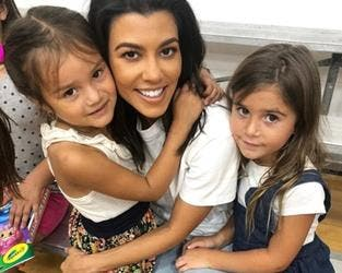 Kourtney Kardashian (middle), 39, brought her daughter Penelope, six (right), to the Watts Empowerment Center this Wednesday, where the little girl 'made a new friend' (left) (Instagram)