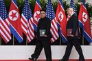 President Trump and North Korean leader Kim Jong Un carry their documents after the signing ceremony at the end of their summit. (AFP)