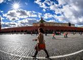 A woman walks on Red Square in front of the Kremlin in downtown Moscow (AFP)