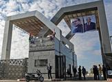 Portraits of Egyptian President Abdel Fattah al-Sisi and Palestinian leader Mahmud Abbas hang at the Rafah border crossing with Egypt. (AFP/File)