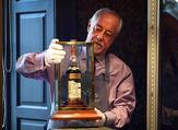 A Bonhams porter shows the bottle of Macallan Valerio Adamai 1926 whisky to packed auction house in Edinburgh today. The whisky was bottled in 1986 having been stored in a vat for 60 years previously (AFP)