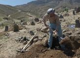 An Afghan man digs a grave for one of the 57 victims of a bomb blast before the burial, a day after the attack on a voter registration center in Kabul. (AFP/ File Photo)