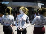 Imelda Cortez, 20, is facing 20 years in jail after she was charged with attempted murder for giving birth to her abuser's baby in a toilet in El Salvador. Pictured: Members of a feminist organisation demonstrate in favour of abortion rights outside the Courthouse of San Salvador  (AFP)