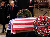 The Trumps paying final respects (AFP)