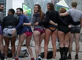 Another group posed at Canada Wharf as they took part in the No Trousers On The Tube event (AFP)