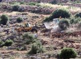 Bulldozers clear land for a new settlement in the West Bank village of Wadi Fukin. ( AFP/File)