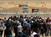 Palestinian demonstrators gesture towards Israeli forces during clashes along the Gaza border (AFP photo)