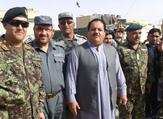Helmand's security chief Abdul Jabar Qahraman (C) surrounded by police and army officers. (Social Media)
