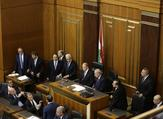 Lebanese President Michel Aoun (C) waits next to the Parliament Speaker Nabih Berri (R) at the Lebanese parliament in Beirut. (Joseph Eid / AFP)