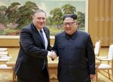 US Secretary of State Mike Pompeo, left, with North Korea leader Kim Jong Un (AFP Photo)