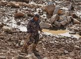 A member of a Jordanian rescue team searches for missing persons following flash floods in the city of Madaba near the capital Amman on November 10, 2018. (KHALIL MAZRAAWI / AFP)