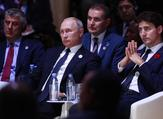 Kosovo's President Hashim Thaci (L), Russian President Vladimir Putin (C) and Canadian Prime Minister Justin Trudeau (R) attend the opening session of the Paris Peace Forum. (GONZALO FUENTES / POOL / AFP)