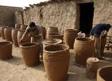 Iraqis making clay pots in Najaf on November 11, 2018. Pottery has deep roots in Iraq, where ancient civilisations turned to clay to build their homes, shape their cooking utensils, and even make their ovens. Haidar HAMDANI / AFP