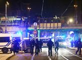 French police officers block the road near the site where Cherif Chekatt, the alleged gunman who had been on the run since allegedly killing three people at Strasbourg's popular Christmas market. (AFP)