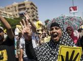 Supporters of ousted Egyptian president Mohamed Morsi raise posters with the four-finger symbol during a demonstration against the military-backed government in the Egyptian capital, Cairo.(AFP PHOTO/MAHMOUD KHALED)