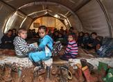Syrian children gather in a tent repurposed as a make-shift classroom, at a camp for the displaced near the town of Sarmada in the northern countryside of the rebel-held Idlib province on December 1, 2018. (File/ AFP