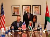 Minister of Planning and International Cooperation Mary Kawar and US Deputy Chargé d'Affaires and USAID Mission Director Jim Barnhart sign a grant agreement in the presence of Prime Minister Omar Razzaz on Tuesday (Petra photo)