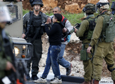 Israeli forces detain a Palestinian youth during clashes near Israel's Ofer prison. (AFP/File)