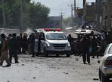 Afghan security forces inspect the site of a suicide attack near Kabul airport. (AFP Photo/Shah Marai)