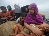 Rohingya Muslims trying to cross the Naf river into Bangladesh to escape sectarian violence in Burma. (AFP)