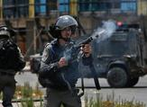 An Israeli border guard fires a teargas canister towards Palestinian protesters during clashes near the settlement of Beit El, near the occupied West Bank city of Ramallah. (AFP/File)