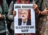 A woman holds a portrait of missing journalist and Riyadh critic Jamal Khashoggi. (AFP/File)