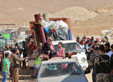 Lebanese security forces check identity and papers of Syrian refugees getting ready to cross into Syria from the eastern Lebanese border town of Arsal, Lebanon. (AFP)