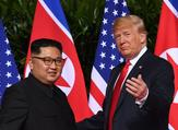 US President Donald Trump meets with North Korea's leader Kim Jong-un at the start of their historic US-North Korea summit. (Saul Loeb/AFP)