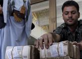 A member of the Houthi militias arranges money donated by Houthi supporters. (AFP/ File Photo)