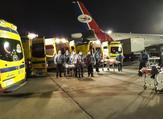 سيارات الإسعاف داخل المطار في استقبال المصابين